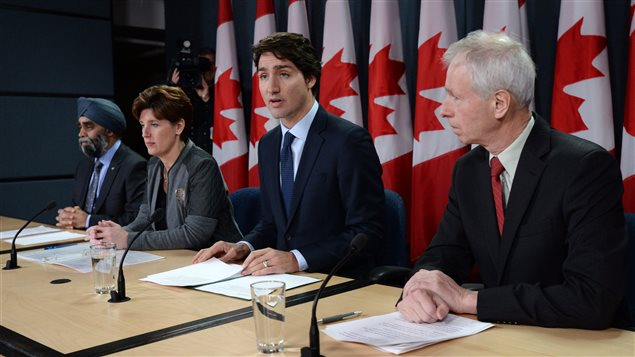 Defence Minister Harjit Sajjan, left to right, International Development Minister Marie-Claude Bibeau, Prime Minister Justin Trudeau and Foreign Affairs Minister Stephane Dion attend a news conference in Ottawa on Monday, Feb. 8, 2016.