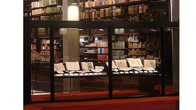 One of the display cases featuring the rare books as part of the *So long lives this* exhibit at the Fisher Rare Book Library at the University of Toronto