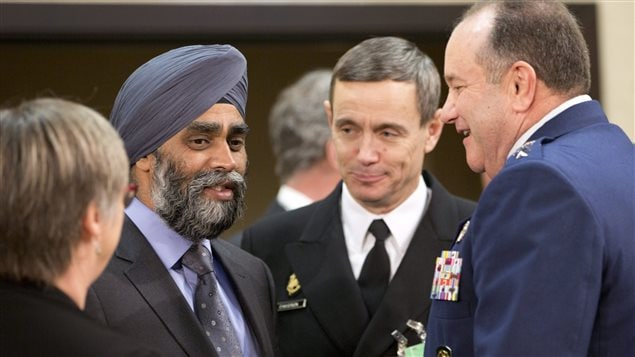 Canadian Defense Minister Harjit Singh Sajjan, second left, speaks with Supreme Allied Commander Europe, Gen. Philip Breedlove, right, during a meeting of the North Atlantic Council at NATO headquarters in Brussels on Wednesday, Feb. 10, 2016.