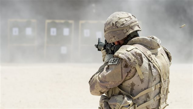 A member of Air Task Force - Iraq Auxiliary Security Force (ASF) takes aim at a shooting range in Camp Patrice Vincent, Kuwait, during Operation IMPACT. (Photo: OP IMPACT, DND)