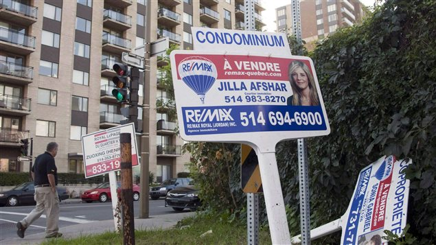 A sale signs stand in front of a condominium Tuesday, September 27, 2011 in Montreal. According to statistics released on Feb. 16 by The Canadian Real Estate Association (CREA), national home sales rebounded in January 2016 compared to the previous month.