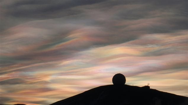 23 Aug 2009: irridescent clouds over the NASA Radome, McMurdo Station, Antarctica. While they can be beautiful, they also indicate the presence of compounts which destoruy the protective ozone layer