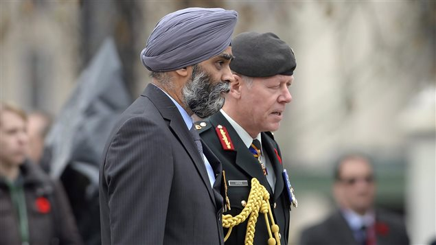 Defence Minister Harjit Singh Sajjan, left, and Chief of Defence Staff Gen. Jonathan Vance attend the Remembrance Day ceremony in Ottawa on Wednesday, Nov. 11, 2015.