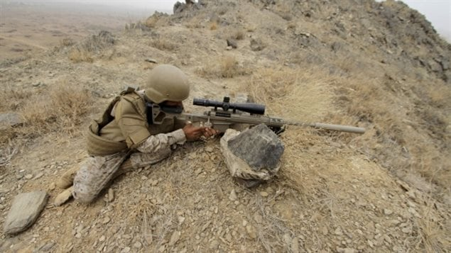 A member of the Saudi forces on the border with Yemen aiming what appears to be a PGW *Timberwolf .338* sniper rifle.