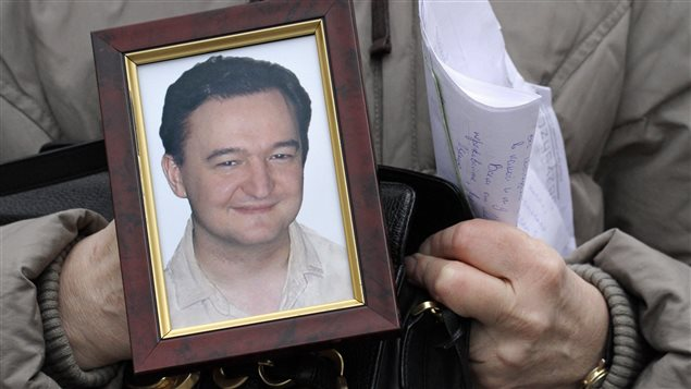 The U.S. law is named after lawyer Sergei Magnitsky who died in a Russian prison. The portrait is held by his mother on Nov. 30, 2009.