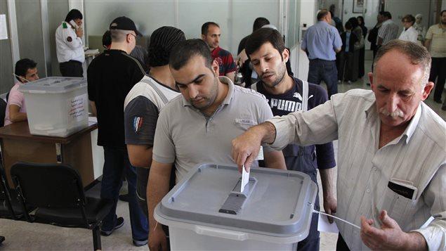 Un bureau de vote à Damas lors des législatives en Syrie en 2012.