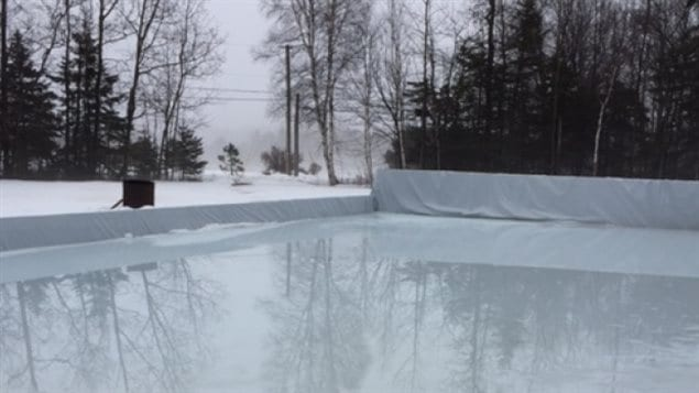 Backyard rinks across Canada, like this one in Stratford, Prince Edward Island, are melting in the erratic tempertures this winter