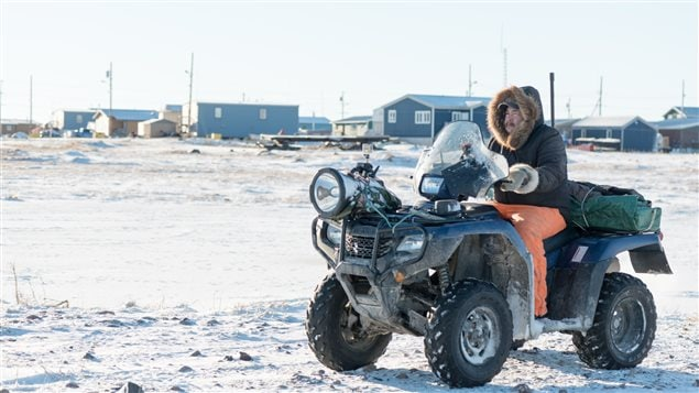 Polar bear patrol guard Leo Ikakhik in Arviat, Nunavut. The ATV along with noisebakers, bean bag guns, and other devices are used to scare the bears away from town. Firearms are now a last resort.