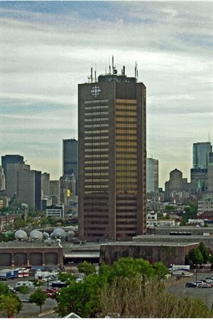 The Maison Radio-Canada in Montreal.View from the east, with loading bays, ground-level structures and parking area visible. RCI now occupies a small section in the below ground level B. As of 2016 the entire building is listed for sale.