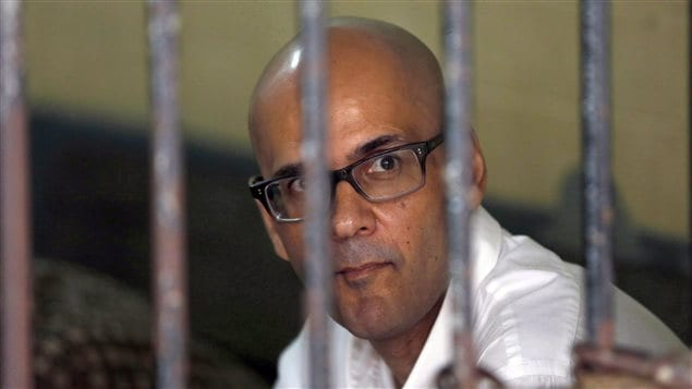Canadian teacher Neil Bantleman is shown sitting inside a holding cell prior to the start of his trial hearing to listen to the prosecutor's demand at South Jakarta District Court in Jakarta, Indonesia on March 12, 2015. Foreign Affairs Minister Stephane Dion said the Canadian government *is deeply dismayed and shocked* by an Indonesian Supreme Court decision to overturn the acquittal of Canadian schoolteacher Neil Bantleman.