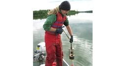 Diane Orihel collecting samples of sediment from Nakumun Lake, Alberta