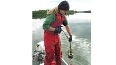 Diane Orihel collecting samples of sediment from Nakumun Lake, Alberta