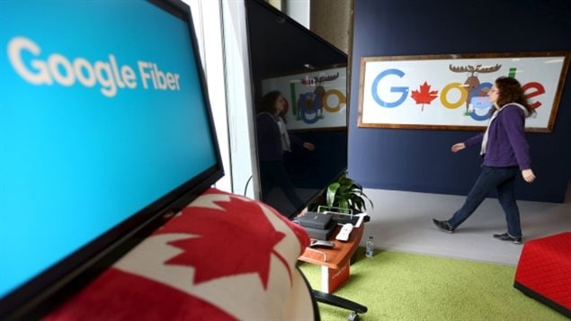 y to go to breach the gender wage gap in Canada. We see a woman walking through the lobby of an office. We see the Google logo on a wall behind her and a Canadian flag in the foreground.