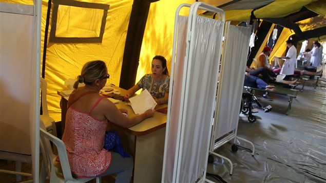 A woman receives medical counselling at a medical mobile unit in Brasilia, Brazil on Feb. 17, 2016. The unit was set up for those affected by diseases like Zika which are transmitted by mosquito.
