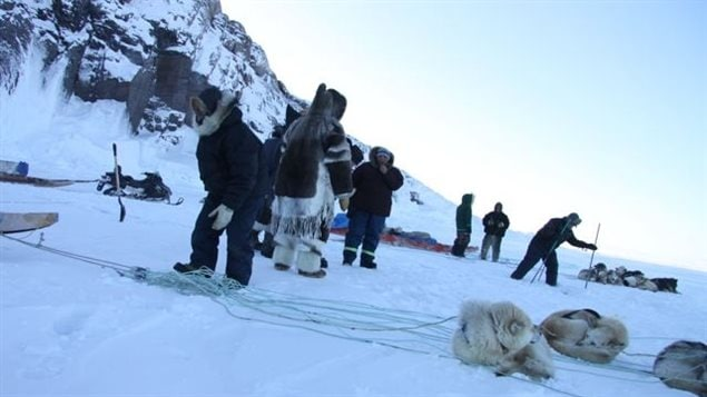 Inuit hunters set up seal nets under the ice near Clyde River, Nunavut. Photo by Levon Sevunts
