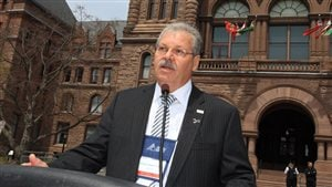 Shown speaking at Queen's Park, Toronto (Ontario legislature) Warren (Smokey) Thomas, President of the Ontario Public Service Employees Union (OPSEU) is strongly opposed to privitization of public health care saying health care should be about people not profit