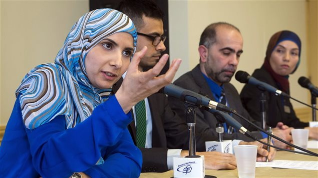 Vice-president of the Canadian Muslim Forum, Kathy Malas, left to right, speaks to reporters as Sameer Zuberi, Samer Majzoub, and Samah Jabbar look on at a news conference in Montreal on Friday, February 20, 2015.