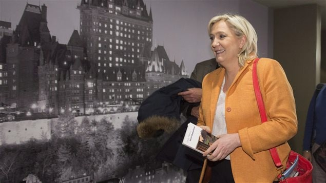 France Front National Leader Marine Le Pen leaves a news conference, Sunday, March 20, 2016 in Quebec City. THE CANADIAN PRESS/Jacques Boissinot