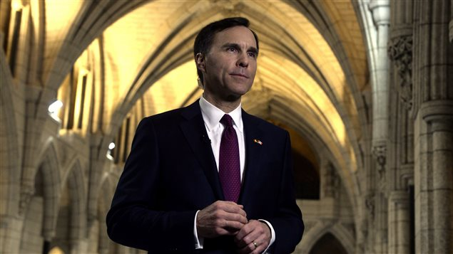 Minister of Finance Bill Morneau takes part in media interviews in the foyer of the House of Commons after delivering the federal budget on Parliament Hill in Ottawa on Tuesday, March 22, 2016.