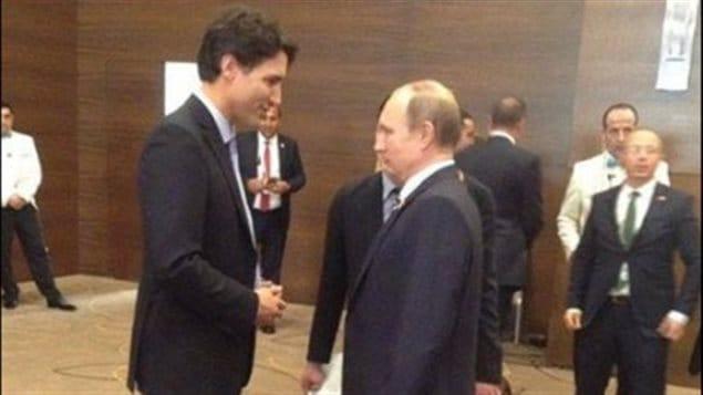 El primer ministro de Canadá, Justin Trudeau y el presidente ruso, Vladimir Putin.