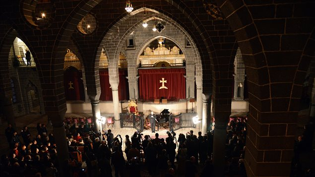 People attend a concert by Armenian pianist Raffi Bedrosyan (C) at the newly restored Surp Giragos (Saint Giragos) Armenian Apostolic church in Diyarbakir on April 23, 2015, during a commemoration marking the 100th anniversary of the Armenian genocide by Ottoman forces.