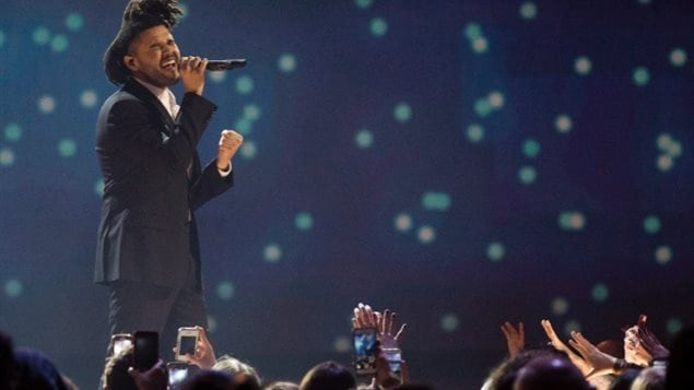 The Weeknd performs during the 2015 Juno Awards in Hamilton, Ontario.
