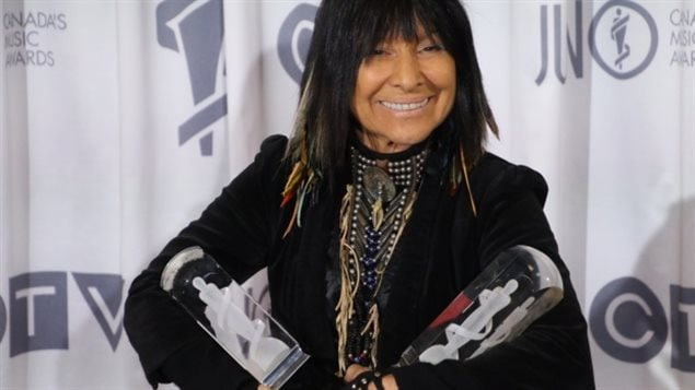 Buffy Sainte-Marie with her two Junos, one for Aboriginal Album of the Year and another for Contemporary Roots Album of the Year.