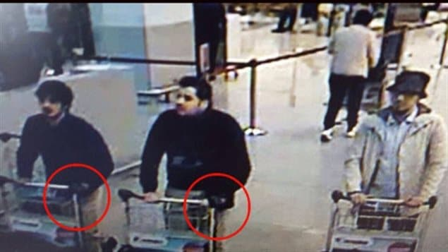 This image, released by the French-language daily newspaper La Dernière Heure, shows the three men who are suspected of participating in the attack on the Brussels airport in March