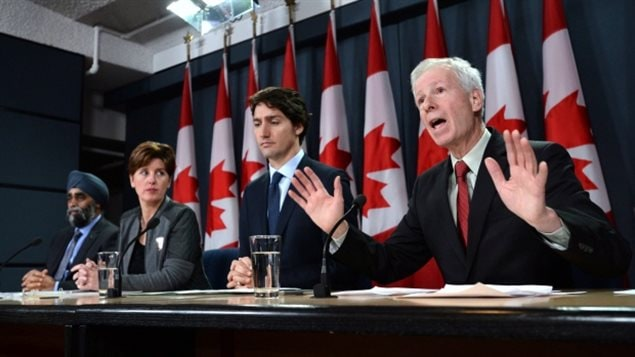From right to left: Minister of Foreign Affairs Stephane Dion delivers a statement as he is joined by Prime Minister Justin Trudeau, Minister of International Development and La Francophonie Marie-Claude Bibeau and Minister of National Defence Harjit Sajjan during a press conference at the National Press Theatre in Ottawa on Monday, Feb. 8, 2016.. This week Dion re-iterated that the government would not use the term *at war* to describe actions agains Daesh (ISIS-ISIL)