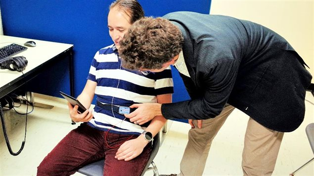 Applying heart-rate monitor system to subjects in the experiment