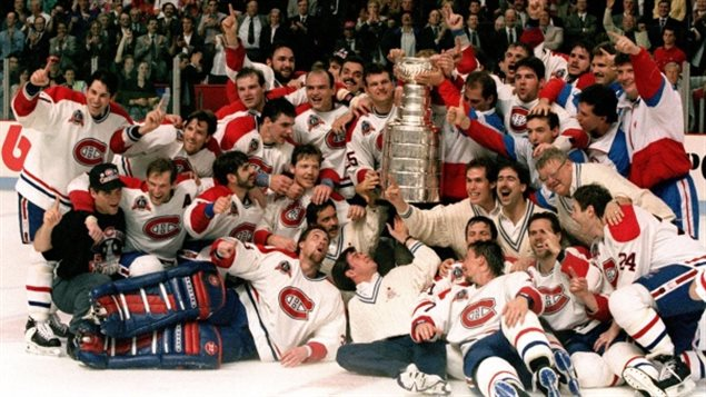 The Montreal Canadiens were the last Canadian team to win the Stanley Cup, in 1993. It won't be happening this year.  We see the traditional team shot. The players (in white) grin wildly as some lie on the ice and others stand behind them. All have their arms wrapped around each other. In the middle of them is the Stanley Cup, looking very regal indeed.