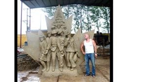 Artist Tim Schmalz with the clay model of one of his military memorials