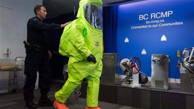 At a news conference in British Columbia on September 3, 2015, police displayed the kind of protective suit they must wear when entering illegal fentanyl production facilities.