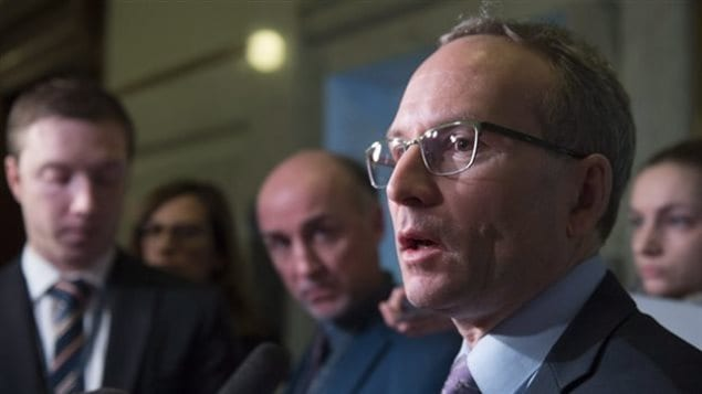 The Quebec Premier, Philippe Couillard says he will whip the vote on Bill 64. Public Security Minister Martin Coiteux (shown here) has labelled gun owners opposed to the bill as *anarchistes*.