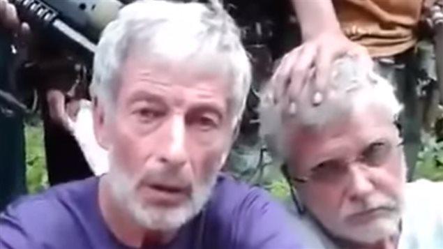 John Ridsdel, au centre, et Robert Hall, enlevés aux Philippines en septembre 2015 par Abou Sayyaf.