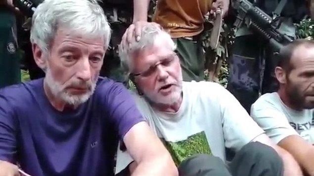 Robert Hall, left, and John Ridsdel are seen in this still image taken from an undated militant video. Canadians Hall and Ridsdel, a Norwegian man and a Filipina woman were taken hostage by gunmen from the Holiday Ocean View Samal Resort on Samal Island in the Philippines in September. THE CANADIAN PRESS/HO via Youtube
