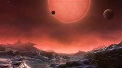 Représentation artistique de l'étoile naine extrêmement froide TRAPPIST-1 depuis la surface d'une de ses planètes.