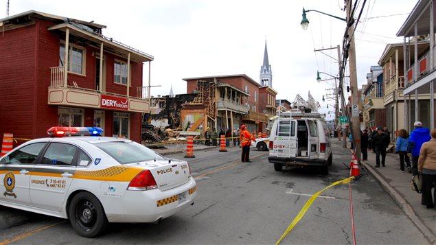 La Sureté du Québec enquête afin de déterminer la cause de l'incendie du premier mai 2016. Portneuf rue Saint-ignace feu sinistre enquêteur