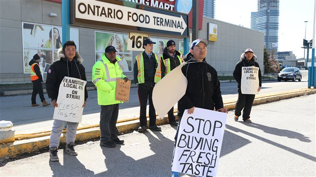 Tibetan Fresh Taste workers strike for equal pay at the Ontario Food Terminal on April 9, 2016.