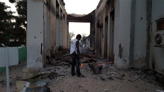 A Doctors Without Borders staff member walks through the grounds of the Kunduz trauma centre in Afghanistan shortly after sustained bombing on Oct. 3, 2015. Dozens died.
