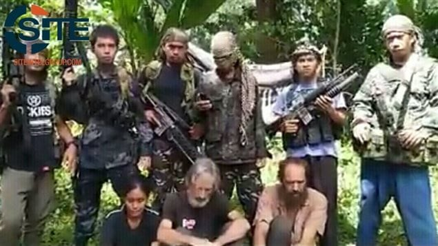 Abu Sayyaf, the Philippine militant group behind the beheading of Canadian hostage John Ridsdel (in the centre), has reportedly released a new video apparently showing the three remaining hostages, including Canadian Robert Hall.