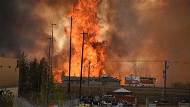 An image of the fire Tuesday as it burned into the town.