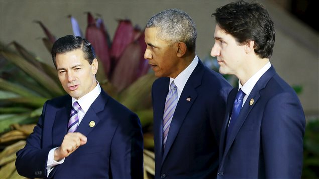 Mexican President Enrique Pena Nieto (L) gestures as he talks with U.S. President Barack Obama (C) and Canadian Prime Minister Justin Trudeau prior to a group family photo at the Asia-Pacific Economic Cooperation (APEC) summit in Manila, November 19, 2015.