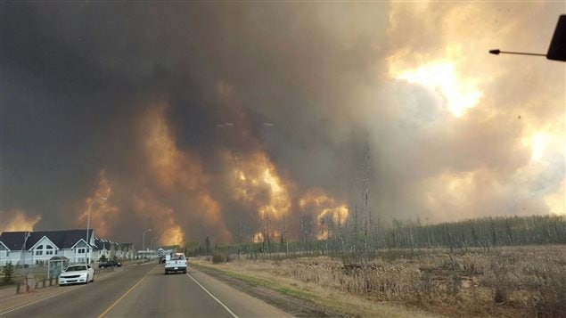 A wall of fire rages outside of Fort McMurray, Alta. Tuesday May 3, 2016 as a wildfire threatened the city.