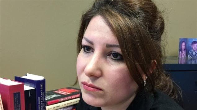 Bahareh Esfand arrived in Canada as the wife of a political refugee. Immigration officials wanted to strip her of her permanent resident status because she went back to Iran for a visit with her mother.
