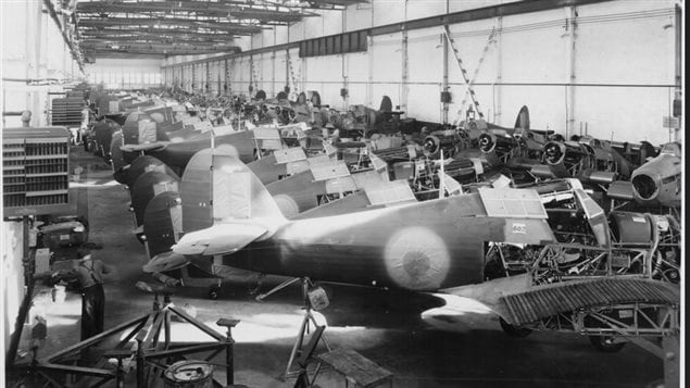 Sept 18, 1941 Dozens of Hurricanes undergoing assembly and painting at Canadian Car and Foundry, Fort William (now Thunder Bay) Ontario. Elsie MacGill was Chief Engineer of the plant.