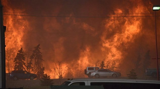 A wall of fire rages outside of Fort McMurray, Alta. Tuesday May 3, 2016.