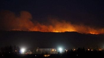 Fire burns in Taylor, British Columbia not far from an emergency response centre.