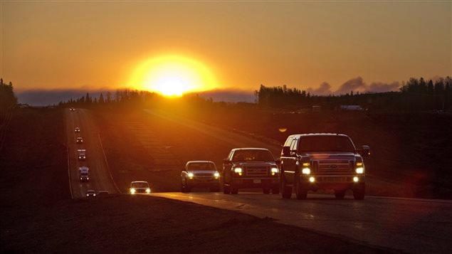 Evacuees leave Fort McMurray in the early morning, after being stranded north of wildfire in Fort McMurray, Alta., on Friday, May 6, 2016. An ever-changing, volatile situation is fraying the nerves of residents and officials alike as a massive wildfire continues to bear down on the Fort McMurray area of northern Alberta.