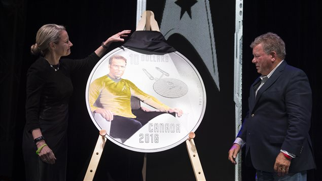 Royal Canadian Mint President and CEO Sandra Hanington and actor William Shatner unveil the first coin in a new collection celebrating the 50th anniversary of Star Trek: The Original Series at the Canada Aviation and Space Museum in Ottawa, Ontario on May 12, 2016.